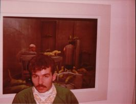 """John always hated this picture, thought I didn't give him enough time to compose his face, but it's the only one we have of Michael Mayer's favorite art piece, something that was called or we called """"Radioactive Cats""""."""