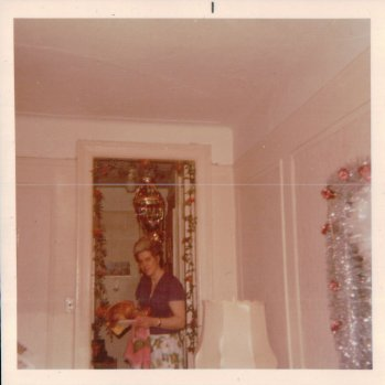 Mom and the Christmas turkey. Early 70s I would guess.